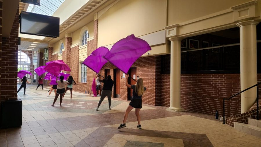 With flags high during second period, the Colorguard team practices for their fall show. The group started practicing for their skills over the summer along with the Mighty Eagle Band. The Colorguard will perform alongside the band at the first home varsity football game.