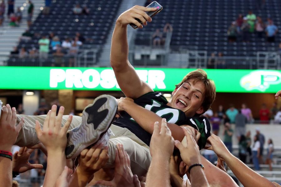 Phone raised to take a selfie, junior Harrison Rosar crowd surfs after Meet the Eagles. Rosar holds the position of quarterback for the varsity football team and also plays varsity baseball. Im very excited for this season, Rosar said. We have a whole bunch of weapons in the offense, a whole bunch of guys to replace on the defense, but Im sure our guys will step up and fill those roles.