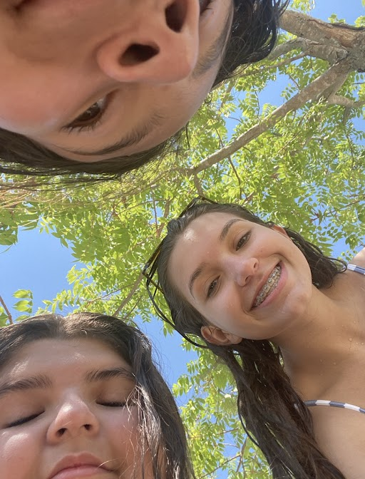 """As summer comes to an end, freshman Sofia Ayala spends the day with her friend Bri Smith and sister Michelle Ayala. Sofia, Michelle and Smith headed to their community pool on July 30 for this picture. """"It's always fun going to the pool with friends in the summer,"""" Michelle Ayala said. """"Before you know it, it will be fall."""""""