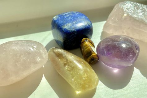 From left to right, rose quartz, citrine, lapis lazuli, tigers eye, amethyst and a second rose quartz stone are pictured on junior Kalyani Raos windowsill. All of them were purchased from local crystal shops. I really like having crystals in my room, Rao said. Seeing the sunlight shine through all the tiny facets and imperfections on the stones is just gorgeous. No crystal is exactly the same as another one, and I find that so beautiful.