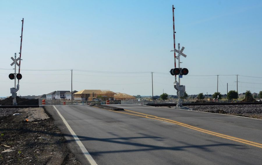 The detour, classified as part of Prairie Crossing, for Frontier Parkway sits in the morning before school traffic begins. The detour was opened for the public Aug. 5 to make up for the construction of the Frontier Parkway overpass and expansion of the road. The detour will be used for the remainder of the construction, which is targeted to finish in the summer of 2023.