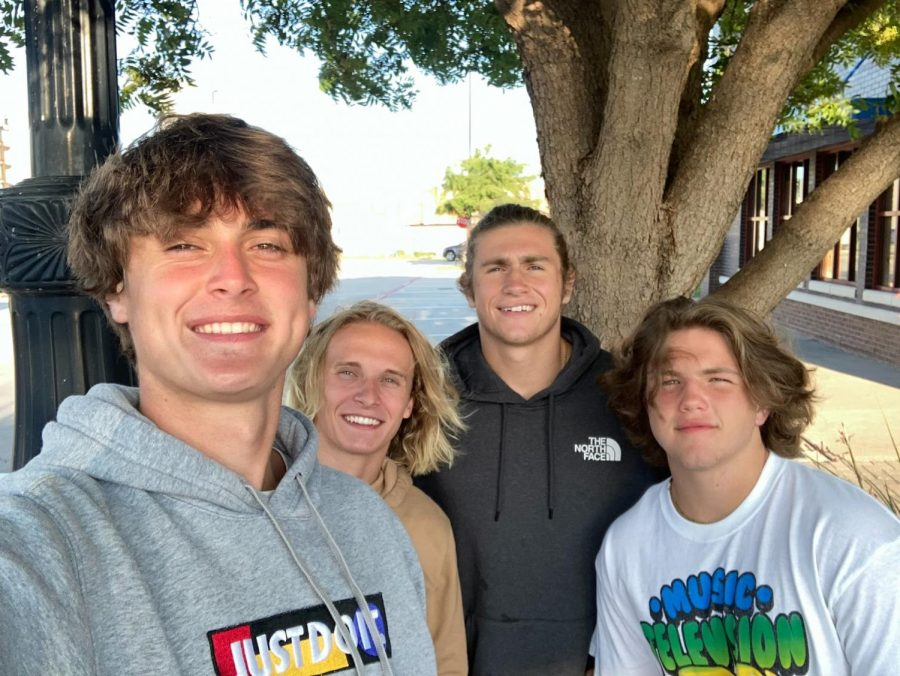 Adjusting the camera, senior Thomas Trautmann takes a picture with prosper alumni Brett Pierce, Jack Simonini, and senior Sam Simononi. Trautmann has been ranking No.1 in his class since freshman year. Thomas is a good friend. He is loyal and always fun to be around, Simonini said. He's always there for me when I need him. He is a good guy in general.