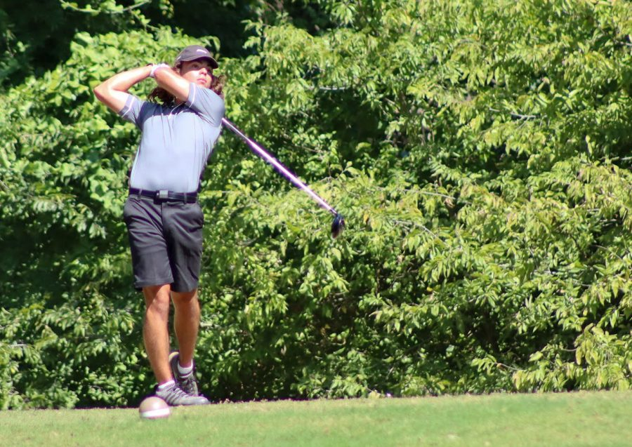 Swinging his club, senior Santiago Arredondo competes in a tournament. The golf team attends multiple competitions throughout the school year. Arredondo is on the varsity boys golf team.