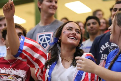 With a smile on her face, senior Riley Smith joins other student council members in the pep rally. Student council members  show school spirit at the pep rallies. We always contribute and dress up, junior Michelle Jordan said. And we make sure everyone is having fun, too.