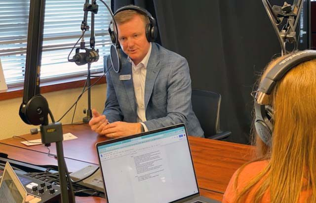 Seniors Amanda Hare and Morgan Reese interview district attorney Jeff Crownover. Crownover first work as a teacher, but then went back to law school. He now combines his love for education and the law as he works for the district.