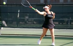 Tossing the ball, senior Mia Camilleri gets ready to serve. She and her doubles team partner lost to Allen. The match was played Tuesday, Sept. 17, at 4 p.m.