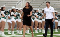 Walking across the field, swim coaches Lena Harrington and Keenan Fogelberg are introduced to the Prosper community for the first time. Harrington and Fogelberg were both hired this year. Harrington is the head swim coach and Fogelberg is the assistant swim and dive coach.