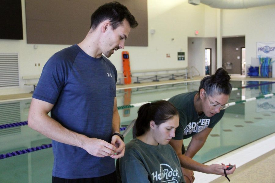 Helping+his+athletes+log+their+lap+time%2C+assistant+swim+and+dive+coach+Keenan+Fogelberg+gives+advice.+This+is+Fogelbergs+first+year+coaching+at+Prosper.+Before+this+I+was+in+Dallas+and+before+that+I+was+in+Orem%2C+Utah%2C+Fogelberg+said.+Yes+I+have+coached+football+before+officially+and+I+unofficially+helped+out+freshman+soccer+as+well.+