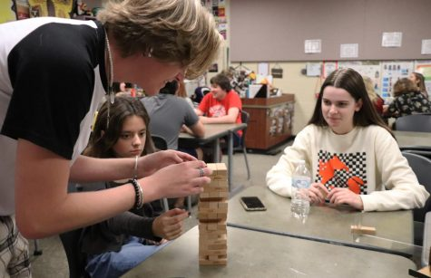 Placing his block on top of the stack, junior Tate Lauby plays Jenga with sophomore Rachel Jackson and senior officer Marlee Parrish. Lauby plays the perfume maker in the fall show Kodachrome, which will open on Oct. 14. As a cast member for Kodachrome, Im super excited for the show, Lauby said. Weve been working so hard to prepare for it to be great. Im extremely ready to get on the stage and preform once again.