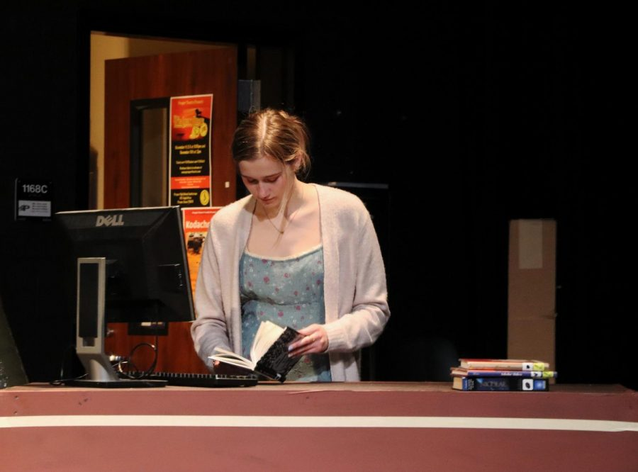 Looking down at her book, the Librarian, played by junior Madeleine Wentz, stands in front of her computer. Wentz is also a member of Eagle Nation News. Im most excited about rehearsing, developing, and performing my monologue, Wentz said. Its such a touching and important moment and I hope to bring a tear to the audiences eye.