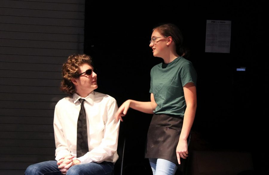 The Waitress, played by freshman Trinity Kelley, discusses with the Policeman played by junior Cooper Smith.  Both actors have performed in multiple of the theatre departments plays. If she were to act in this production again, Kelley said she would want to play the Gravedigger.
