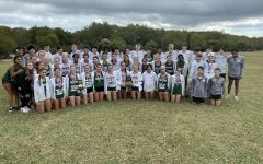 After winning their meet, varsity and junior varsity cross country gathers together. The varsity girls team had all seven of them place in the top 14. The meet took place at Myer's Park on Friday, Oct. 15 at 8 a.m.