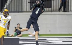In the endzone, senior wide reciever Houston Hawkins catches the ball for a touchdown. The game was played Friday, Oct. 8 at Childrens Health Stadium against McKinney. The team has a bye week, with their next game being Friday, Oct. 22 away at Denton Braswell.
