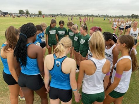 Together, the Prosper and Rock Hill cross country teams pray at their meet Saturday, Oct. 2. Both the varsity and junior varsity girls teams won in the meet. Cross country meets usually occur on Saturdays at 8 a.m.