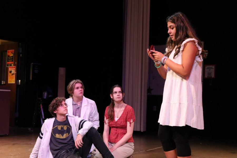 On+the+stage%2C+sophomore+Titus+Boyd%2C+junior+Tate+Lauby%2C+senior+Marlee+Parrish+and+freshman+Sophia+Gomez+rehearse+for+their+Kodachrome+play.+The+plays+first+show+is+Thursday%2C+Oct.+14.+There+are+more+Kodachrome+performances+Friday+and+Saturday%2C+Oct.+15+and+16.
